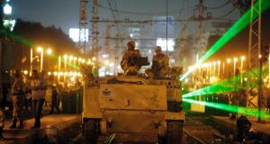 Soldiers  patrol  tension-filled streets in Cairo. Photograph: Asmaa Waguih/Reuters
