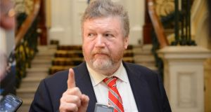 "Minister for Health James Reilly  told the Joint Oireachtas Committee on Health and Children yesterday that the current system was ""immoral and wrong"". Photographer: Dara Mac Dónaill"