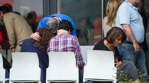 Relatives of passengers involved in the crash comfort each other, as they wait for news. Photograph:  David Ramos/Getty Images