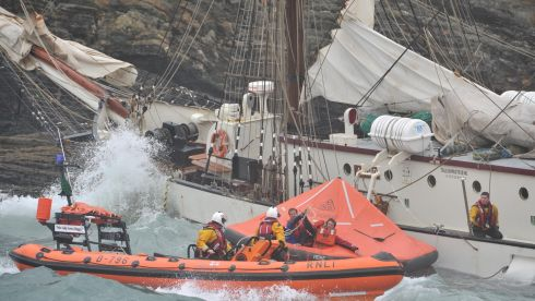 All 30 crew and trainees were taken off the Dutch registered ship after it lost power leaving Oysterhaven with the Gathering cruise. Pictured are Courtmacsherry and Kinsale inshoire lifeboats rescuing a sailor. Photograph: Michael Mac Sweeney/Provision