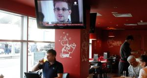 A television screen shows former US spy agency contractor Edward Snowden during a news bulletin at a cafe at Moscow's Sheremetyevo airport. Photograph: Tatyana Makeyeva/Reuters