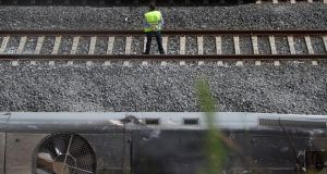 A rail worker stands next to the wreckage of a high speed Renfe train which crashed near  Santiago de Compostela on Wednesday, killing 78 and injuring 170 others. Photograph: Pablo Blazquez Dominguez/Getty Images.