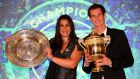 Marion Bartoli of France  with the Venus Rosewater Dish trophy and Andy Murray of Great Britain  with the Gentlemen's Singles trophy for their Wimbledon successes. Bartoli earned €1.86 million in prize money for winning the tournament.  Photograph: Julian Finney/Getty Images