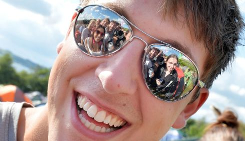 Chris Goemans from Dublin with a bunch of people reflected in his mirror shades. Crazy dude! Photograph: Alan Betson/The Irish Times