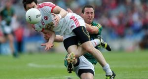 Meath's Graham Reilly tackles Tyrone's Matthew Donnelly during the qualifier at Croke Park. Photograph: Donall Farmer/Inpho