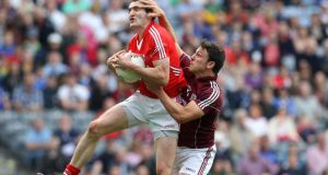Seán Armstrong of Galway challenges Cork's Graham Canty during their All-Ireland SFC Qualifier game at Croke Park.  Photograph:  Ryan Byrne/Inpho