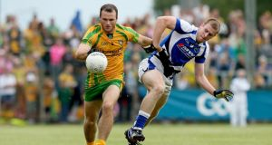 Donegal's Neil McGee and Donal Kingston of Laois in action at Carrick-on-shannon. Phogo: James Crombie/Inpho
