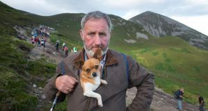 Dominick Geraghty, Carnaross, Kells, Co Meath,with his dog Edward on his way down the mountain during his pilgrimage to Croagh Patrick. Photograph: Michael McLaughlin