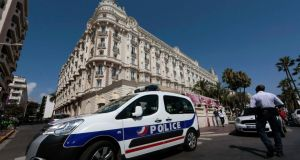 A police car is seen parked outside the Carlton hotel in Cannes yesterday. REUTERS/Eric Gaillard