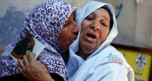 The mother (R) of Palestinian Ateya Abu Moussa, who has been held prisoner by Israel for 20 years, reacts as she is hugged by her sister after hearing news on the possible release of her son. Abu Moussa was expected to be among more than 100 Arab prisoners to be released as a step to renew stalled peace talks with the Palestinians in Washington today. Photograph: Reuters