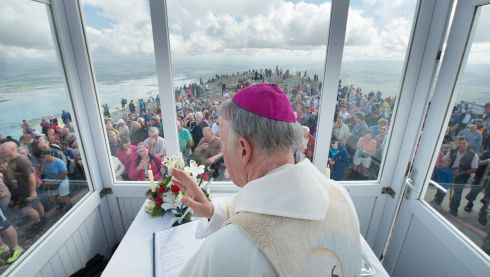 ArchBishop Of Tuam Michael Neary celebrates Mass with Pilgrims on the summit of Croagh Patrick for the annual pilgrimage. Photo: Michael McLaughlin