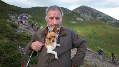 Dominick Geraghty, Carnaross, Kells, Co. Meathwith his dog Edward on his way down the mountain during his pilgrimage to Croagh Patrick. Photo: Michael McLaughlin