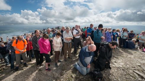 Pilgrims pray during mass on the summit of Croagh Patrick during the annual pilgrimage.  Photo: Michael McLaughlin