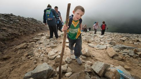 Lorcan Grennan from Kilcormac, Offaly on his first climb up the mountain.  Photo: Michael McLaughlin
