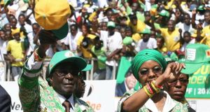 Zimbabwe's president Robert Mugabe and his wife Grace (R) arrive to address the final campaign rally of his ZANU-PF party in Harare. Photograph: Philimon Bulawayo/Reuters.