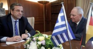 Greek prime minister Antonis Samaras speaks to German Finance Minister Wolfgang Schaeuble (R)  in Athens earlier this month. The IMF today approved the latest release of bailout funds which have been keeping Athens afloat. Photograph:  John Kolesidis/Reuters.