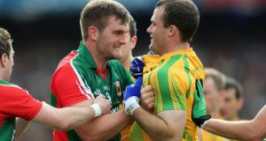 Mayo's Aidan O'Shea and Neil McGee of Donegal are involved in a heated exchange during last year's All-Ireland football final. Photograph: Donall Farmer/Inpho