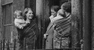 Mothers at the entrance to a tenement building in Dublin, circa 1945. Photograph: Picture Post/Hulton Archive/Getty