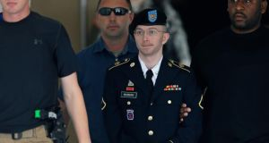 Bradley Manning is escorted from the courthouse at Fort Meade. Photograph: Patrick Semansky