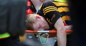 Kilkenny's Riche Power is carried from the pitch having suffered an accidental head injury during the clash against Cork at Semple Stadium last Sunday. Photograph: Donall Farmer/Inpho