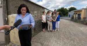Michelle Doorley principal at the National School at Ballinkillen, Co Carlow reading a statement in regards to the deaths of five-year-old Ruairí Chada and his 10-year-old brother Eoghan, pupils of her school. In the background are teachers and staff. Photograph: Dylan Vaughan.