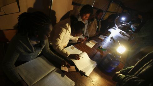 Zimbabwean election officials check documents as voting gets underway. Photograph: Philimon Bulawayo/Reuters