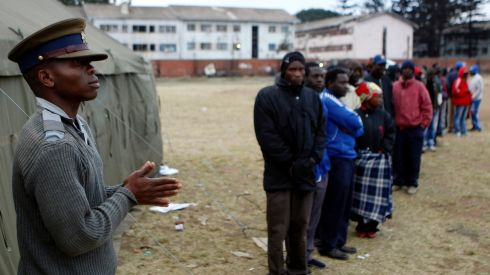 People wait to cast their votes in Mbare township outside Harare. Zimbabweans voted in large numbers on today in a fiercely contested election pitting veteran President Robert Mugabe against Prime Minister Morgan Tsvangirai. Photograph: Siphiwe Sibeko/Reuters