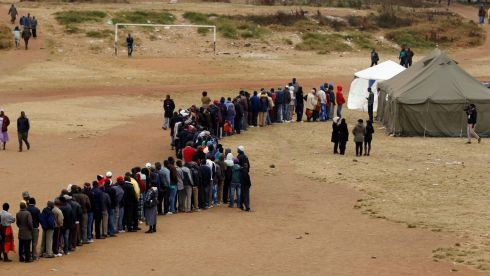 Zimbabweans wait in line to cast their votes in Mbare township outside Harare. Photograph: Siphiwe Sibeko/Reuters.