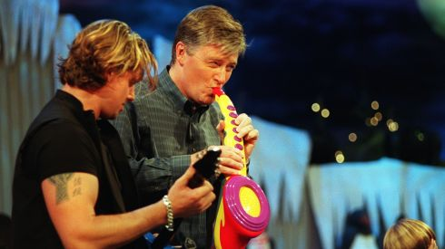 Pat Kenny testing out some musical toys with  , with Boyzone's Keith Duffy . Photograph: Alan Betson /The Irish Times