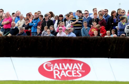Punters enjoy the spectacle at the Galway Races. Photograph: Inpho/James Crombie