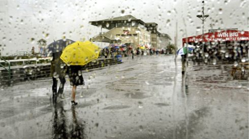 The weather at the Galway Races certainly dampened the mood of the punters. Photograph: Brenda Fitzsimons/The Irish Times