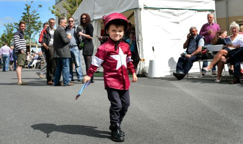Four-year-old Adam Jordan from Navan wearing silks at the Galway Races. Photograph: Brenda Fitzsimons/The Irish Times