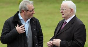 Sport journalists Tony O'Donoghue (left) and Jimmy Magee arrive for the funeral. Photograph: PA