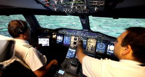 Real deal: two BA pilots in the company's A380 simulator. Photograph: British Airways