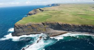 An aerial view of the Cliffs of Moher, Co Clare, during an Aer Arann sightseeing flight. Photograph: Andrew Downes