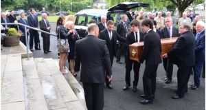 The coffin of RTÉ's Colm Murray is brought into  St Gabriel's Church in Dollymount. Photograph: Bryan O'Brien