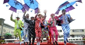 A group from Dalkey, Co Dublin, makes a splash  in aid of Our Lady's Children's Hospital Crumlin during Ladies' Day at the Galway races yesterday. Photograph: Brenda Fitzsimons