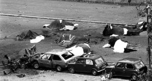 Dead horses covered up and wrecked cars at the scene  in Rotten Row, Hyde Park, after an IRA bomb exploded as the Household Cavalry was passing. Photograph: PA News/PA Wire