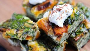 Sweet potato, spinach and feta frittata with yoghurt and sumac. Photograph: Aidan Crawley
