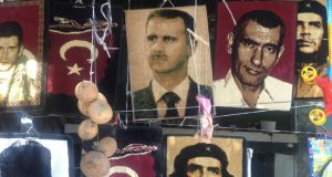 Heroes and villains: a wall hanging of Bashar al-Assad, the Syrian president, on sale in Alawite-dominated Harbiye, close to Turkey's border with Syria. Photograph: Mary Fitzgerald