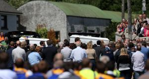 The coffins carrying the bodies of brothers Eoghan and Ruairi Chada are carried into  St Lazerian's church in Ballinkillen, Co Carlow.  Photograph: Julien Behal/PA Wire