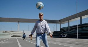 US secretary of state John Kerry participates in an impromptu game of soccer with staff as he waits for his plane to refuel at Vienna airport during a flight from Islamabad to London. In an interview with Pakistani media, Mr Kerry indicated support for Egypt's new army leaders. Photograph: Jason Reed/Reuters.