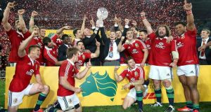 Brian O'Driscoll (centre right) and Paul O'Connell (centre) lift the trophy after the Lions won the Third Test against Australia. Photograph: David Davies/PA Wire.