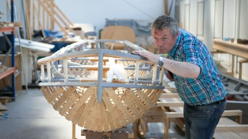 Joe O'Neill working on a boat  at the AK ILEN Wooden Boat Building School in Limerick. Photograph: Brian Gavin Press 22