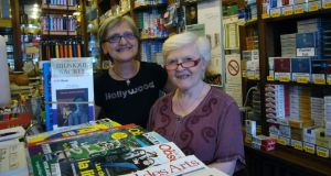 Marie (left) and Janine Péchaud have sold newspapers in their tobacconist shop on the Left Bank for 34 years. Photograph: Lara Marlowe