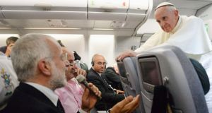 Chatting to the press posse on the return flight from Brazil, Pope Francis got the formal informality down perfectly. Photograph: Reuters