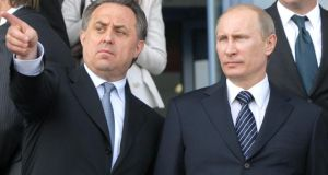 Russian sports minister Vitaly Mutko and   prime minister Vladimir Putin (right).