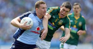 Dublin's Ciarán Kilkenny holds off Meath's Padraic Harnan during the Leinster football final. Photo: Donall Farmer/Inpho