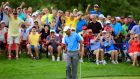 The crowd reacts with Tiger Woods as he makes a birdie putt on the 12th green at Bridgestone Invitational at Firestone Country Club South Course  in Akron, Ohio. Photograph:  Sam Greenwood/Getty Images