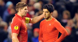 Liverpool midfielder Steven Gerrard believes the club's season depends on keeping hold of Luis Suarez - and says a move to Arsenal 'doesn't make sense at all'. See PA story SOCCER Liverpool. Photo credit should read: Martin Rickett/PA Wire